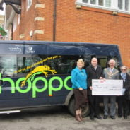 Hoppa receives £5,000 cheque from Farnham Town Council