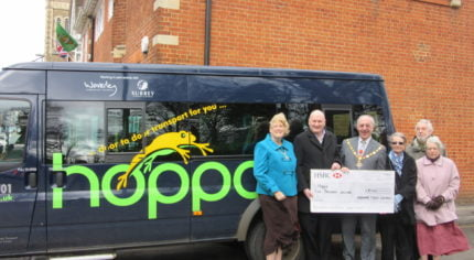 Hoppa receives £5,000 cheque from Farnham Town Council