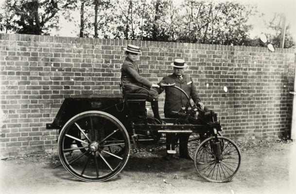 Man and boy with old fashioned car.