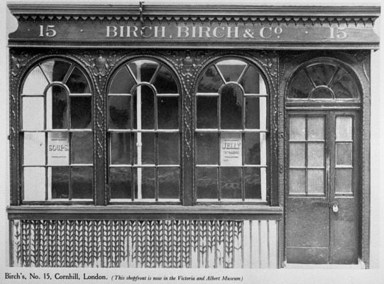 Black and white photo of a shop