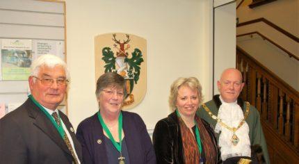 Caption: Cllr David Attfield, Deputy Mayor, Anne Attfield, Cllr Julia Potts, Mayor's Consort and Cllr Mike Hodge, Mayor of Farnham.