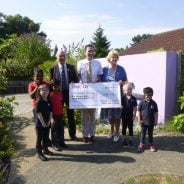John Ward presents large cheque to the Ridgeway School