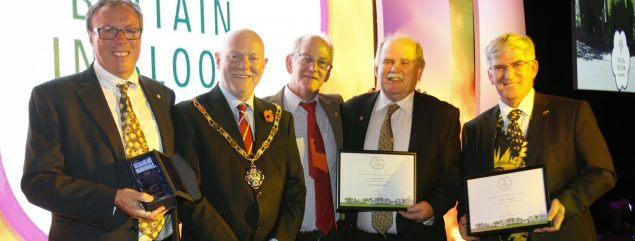 Five males including the Mayor with certificates.