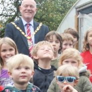 Children and Mayor outside poly tunnel