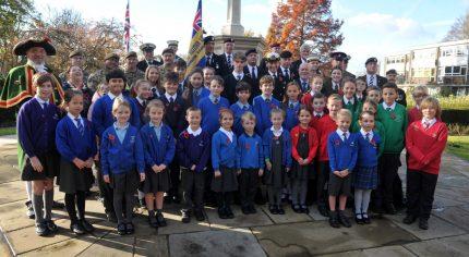 School children at war memorial