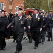 People marching in a remembrance parade.