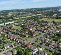Aerial photo of Farnham houses, trees and fields.