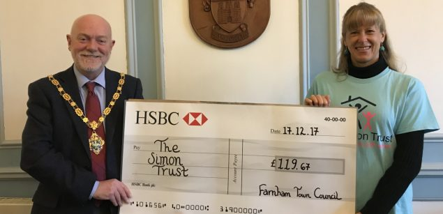 Mayor presents large cheque to a female representing The Simon Trust charity.