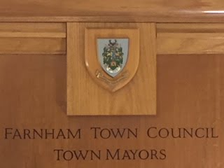 Wooden panel engraved with Farnham Town Council Town Mayors.