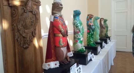 Six large decorated otters.