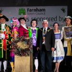 Pantomime cast and Mayor on stage.
