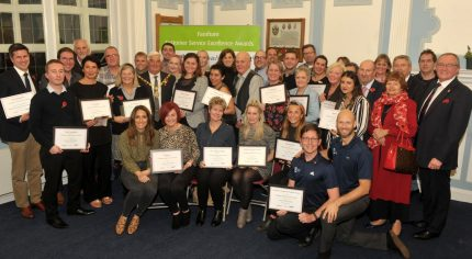 Group of people holding certificates.