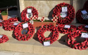 Poppy wreaths at a war memorial
