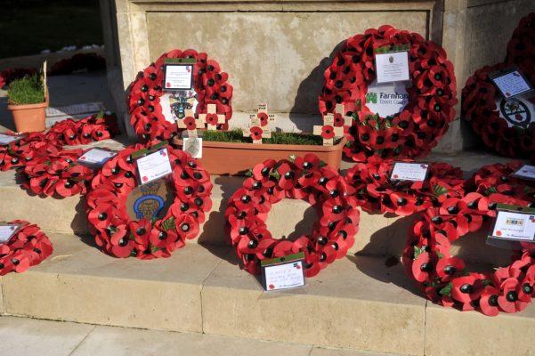Poppy wreaths at a war memorial