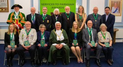 Mayor centre with group of people wearing medals