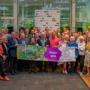 Large group of people holding a Farnham in Bloom banner