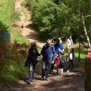 Family walking through woods.