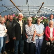 Mayor and a group of people standing inside a large poly tunnel