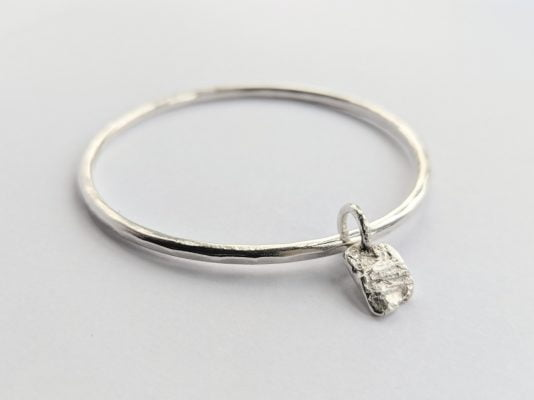 Silver bracelet and charm