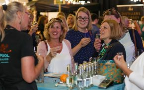 Four females sampling gin