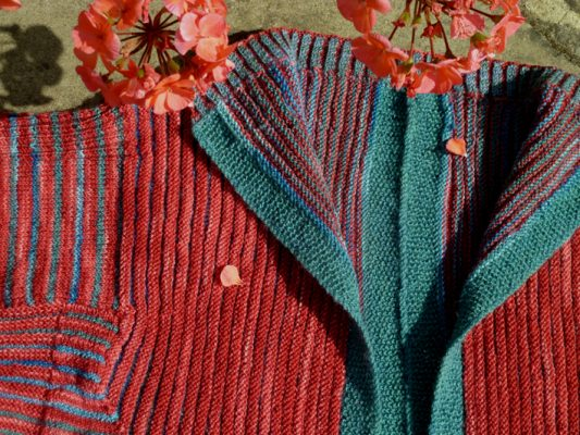 Red and teal knitted cardigan