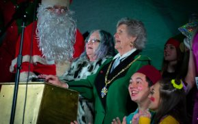 Father Christmas, two females and pantomime characters