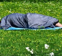 Person sleeping rough on grass