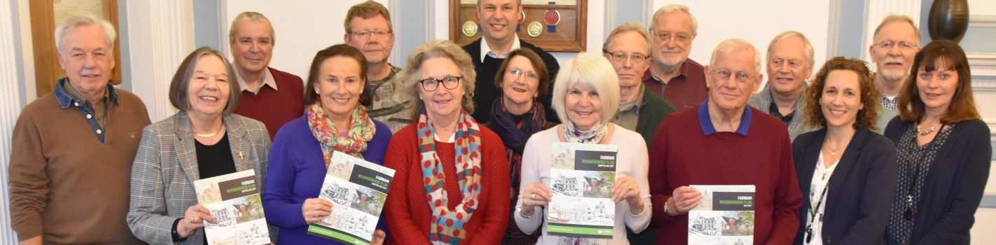 Group of people holding copies of the Farnham Neighbourhood Plan
