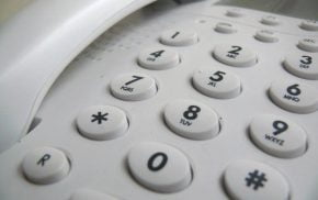 Close up showing push buttons on a white telephone