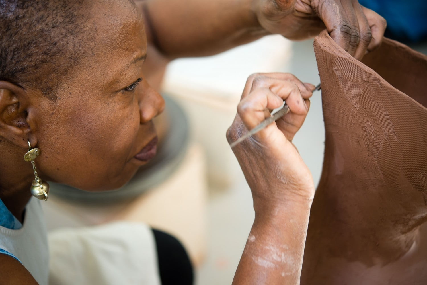 Close up of female working with clay