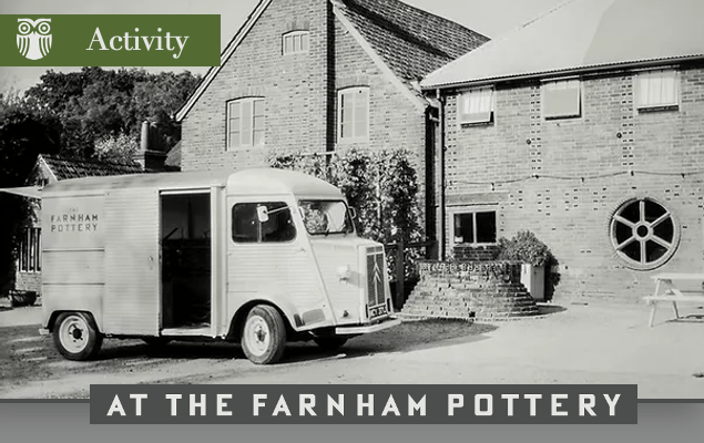 Old black and white photograph of the outside of a pottery and a lorry parked in front.