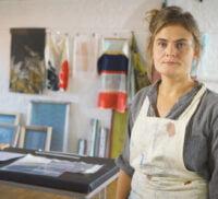 Female artist in her studio