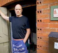Male standing in a doorway