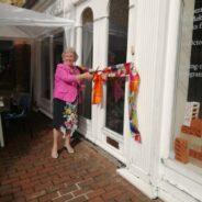 Mayor cuts ribbon at entrance to a building