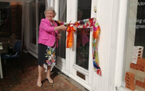 Mayor cuts ribbon at entrance to a building