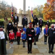 School children, the Mayor and others socially distance at the war memorial.