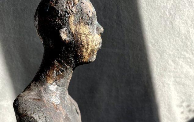 A ceramic sculpture of a person by Su Jameson