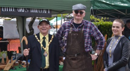Mayor and Mayoress standing next to a man