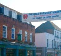 Downing Street and a cross street banner advertising Farnham Farmers' Markets