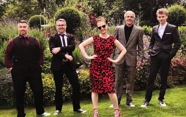 A photo showing members of the TR5's band consisting of 4 men and 1 woman
