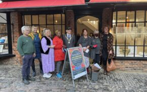 Group of people standing outside a shop